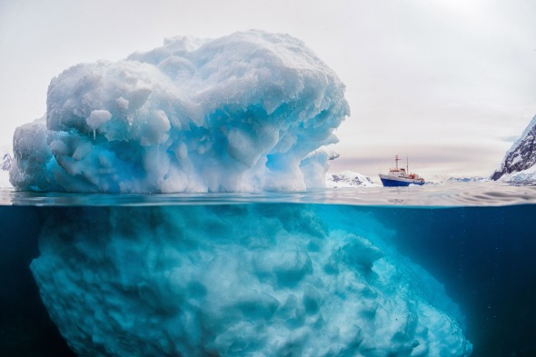 Iceberg appears to make 3,000 tonne ship look tiny, Antarctic Peninsula. - Feb 2016